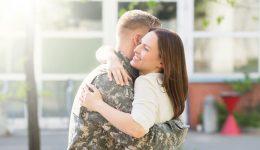 wife hugging army veteran.